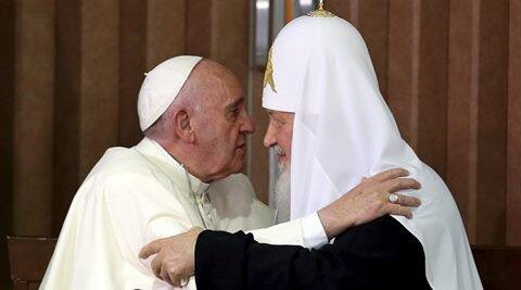 Pope Francis (L) and Russian Orthodox Patriarch Kirill hug each other after signing agreements in Havana, February 12, 2016. REUTERS/Alejandro Ernesto/Pool
