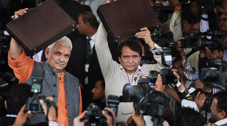 Union Minister for Railways, Suresh Prabhu along with MOS Manoj Sinha arrive at Parliament for presenting the Railway Budget 2016-17, in New Delhi. (Source: PTI)