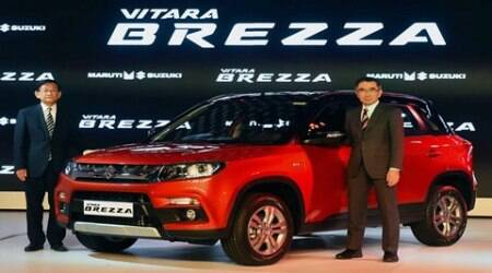 Greater Noida: Maruti officials pose with compact SUV Vitara Brezza at its launch at Auto Expo 2016 in Greater Noida on Wednesday. PTI Photo by Kamal Singh(PTI2_3_2016_000058A)