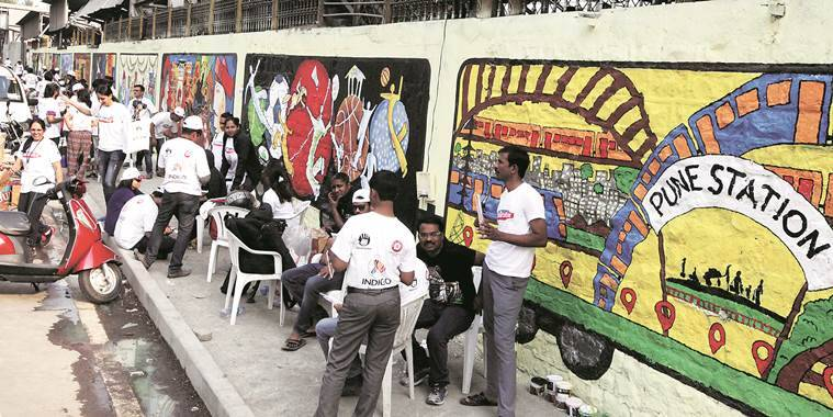 The 5,000 sq ft wall surrounding the Pune railway station was painted with grafitti on Sunday by nearly 320 people who were guided by 26 artists.Express Photo By Sandeep Daundkar, Pune