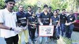 Pune students join volunteer group to clean roads on Sundays