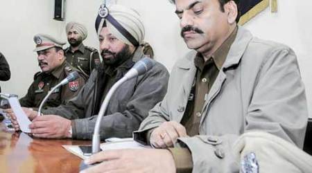 Ludhiana Police Commissioner P S Umranangal (centre) addresses a press conference Friday.  (Express Photo by Gurmeet Singh)