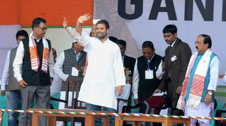 "Sonitpur: Congress Vice President Rahul Gandhi waves to the crowd at ""Micro Level Booth Management Gandhi Sabha "" at Gohpur in Sonitpur on Monday. PTI Photo (PTI2_15_2016_000194B)"