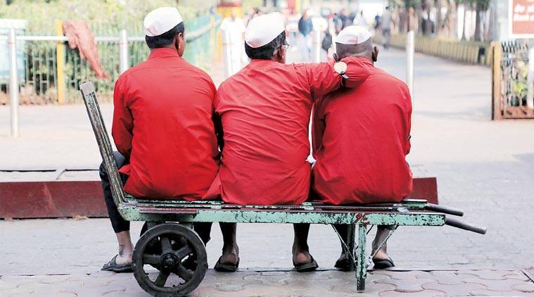 Railway porters in Mumbai on Thursday. They will be called sahayaks, not coolies. (Expres Photo: Amit Chakravarty)