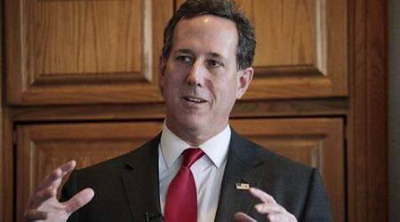 U.S. Republican presidential candidate Rick Santorum visits with supporters at a house party in West Des Moines, Iowa, in this January 31, 2016, file photo.  Santorum plans to suspend his campaign for the White House later on February 3, 2016, CNN reported, citing unidentified sources.  REUTERS/Brian C. Frank/Files