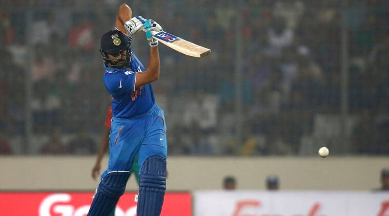 India's Rohit Sharma plays a shot against Bangladesh during the Asia Cup Twenty20 international cricket match in Dhaka, Bangladesh, Wednesday, Feb. 24, 2016. (AP Photo/A.M. Ahad)