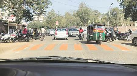 Traffic Colours: Ahmedabad speed bumps first get saffron stripes, painted back inyellow