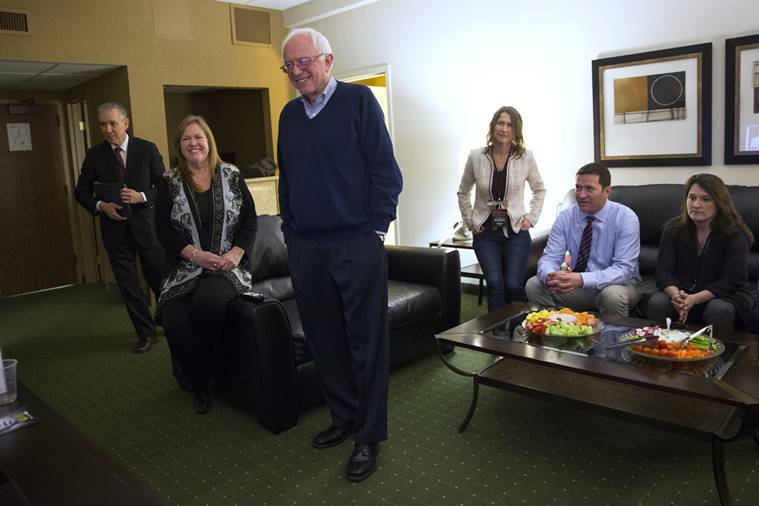 Democratic presidential candidate Sen. Bernie Sanders, I-Vt., watches caucus returns in his hotel room. AP Photo