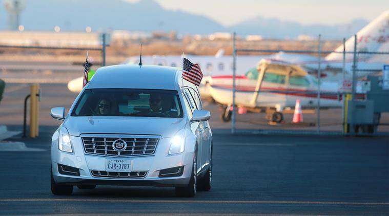 The hearse which transported Supreme Court Justice Antonin Scalia's body to the airport from Sunset Funeral Home departs the Atlantic Aviation hangar at El Paso International Airport in El Paso, Texas, Sunday, Feb. 14, 2016. (VIctor Calzada/The El Paso Times via AP)