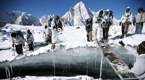 As legend goes, Colonel Narendra Kumar, the legendary  mountaineer after whom the mid way point of Siachen is  named, lost an ice axe presented to him by Indira Gandhi  while trekking up the glacier. The firm belief is that till  the army finds the missing piece of equipment, soldiers are  doomed to stay on the glacier. AT 22,000ft, WITH TEMPERATURES FALLING BELOW MINUS 65 DEGREE CELSIUS, SIACHEN IS THE WORLD'S HIGHEST AND COLDEST BATTLEFRONT. ON AN EIGHT-DAY AND 84 Kms TREK UP THE GLACIER, MEMBERS OF SIACHEN GLACIER TRACKERS CLIMBING ON THE GLACIER TOWARDS CAMP THREE (NEAR KUMAR POST). IT WAS 84 Kms TRACK FROM BASE CAMP TO CAMP-3 AND BACK. IT WAS A CIVILIAN EXPENDITION UP THE SIACHEN GLACIER ORGANIZED BY THE INDIAN ARMY. PHOTO BY -- PRAVEEN KHANNA (17-10-2008) SIACHEN-GLACIER.