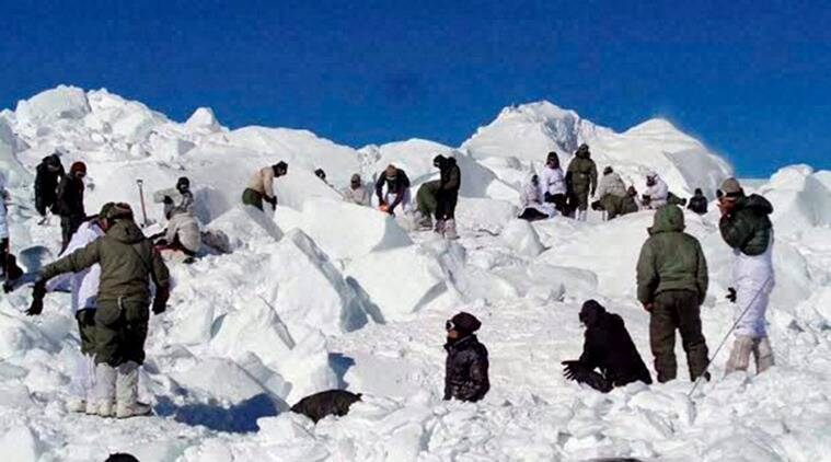 Specialised rescue teams who were carrying out the operations to search for the bodies of the soldiers hit by an avalanche, in Siachen on Tuesday. (PTI Photo)