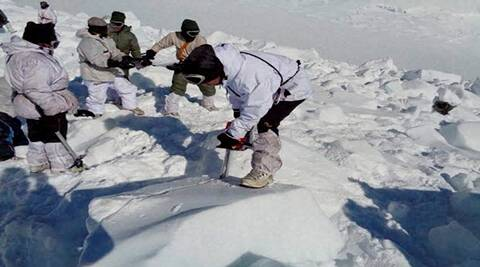 Siachen: Rescuers carrying out the operations to search for the bodies of the soldiers hit by an avalanche, in Siachen on Tuesday. PTI Photo (PTI2_9_2016_000184B)