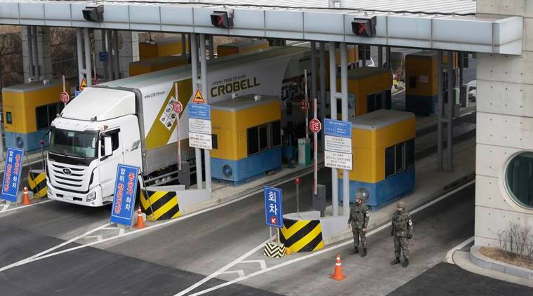 A South Korean cargo truck heads to the North Korean city of Kaesong as South Korean Army soldiers stand guard at the customs, immigration and quarantine office near the border village of Panmunjom, in Paju, South Korea, Thursday, Feb. 11, 2016. South Korean workers on Thursday began shutting down a jointly run industrial park in North Korea, a move that will end, at least temporarily, the Koreas' last major cooperation project as punishment over Pyongyang's recent rocket launch. (AP Photo/Ahn Young-joon)