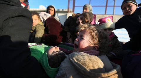A child cries as Syrians arrive at the Bab al-Salam border crossing with Turkey, in Syria, Saturday, Feb. 6, 2016. Thousands of Syrians have rushed toward the Turkish border, fleeing fierce Syrian government offensives and intense Russian airstrikes. Turkey has promised humanitarian help for the displaced civilians, including food and shelter, but it did not say whether it would let them cross into the country. (AP Photo/Bunyamin Aygun) TURKEY OUT