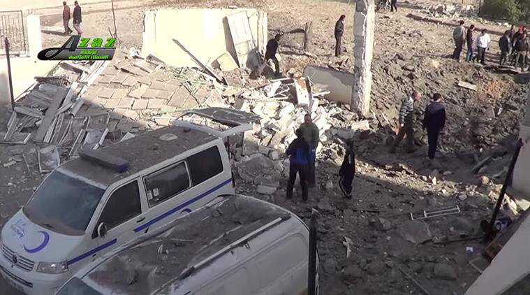 This image taken from video provided by the Syrian activist-based media group Azaz Media Center, which has-been verified and is consistent with other AP reporting, shows people gathered around destroyed vehicles in Azaz, Syria Syria, Monday, Feb. 15, 2016. Turkey says Kurdish forces have been expelled from areas around the northern Syrian town of Azaz after a weekend of cross-border shelling.(Azaz Media Center,via AP Video) MANDATORY CREDIT