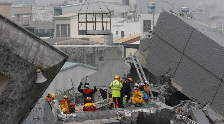 Rescue teams continue to search for the missing in a collapsed building, after an early morning earthquake in Tainan, Taiwan, Saturday, Feb. 6, 2016. A 6.4-magnitude earthquake struck southern Taiwan early Saturday, toppling at least one high-rise residential building and trapping people inside. (AP Photo/Wally Santana)