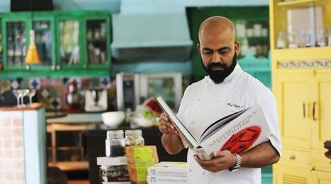 Chef Sujan S with his collection of books at the Olives Bar and Kitchen in Mehrauli, New Delhi Express Photo by Tashi Tobgyal New Delhi 020216