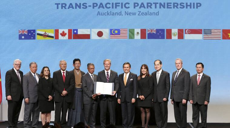 Trade delegates pose for a photograph after signing the Trans-Pacific Partnership Agreement in Auckland, New Zealand, Thursday, Feb. 4, 2016. Trade ministers from 12 Pacific Rim countries including the United States have ceremonially signed the free-trade deal. (David Rowland/SNPA via AP)