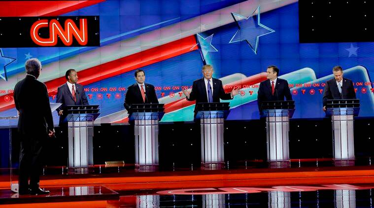 As Republican presidential candidate, businessman Donald Trump, center, speaks, Republican presidential candidates, retired neurosurgeon Ben Carson, left, Sen. Marco Rubio, R-Fla., second from left, Sen. Ted Cruz, R-Texas, second from right and Ohio Gov. John Kasich, right, look on during a Republican presidential primary debate at The University of Houston, Thursday, Feb. 25, 2016, in Houston. (AP Photo/David J. Phillip)