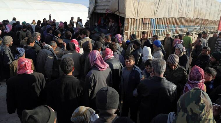 In this photo provided by Turkey's Islamic aid group of IHH, Syrians fleeing the conflicts in Azaz region, congregate at the Bab al-Salam border gate, Syria, Friday, Feb. 5, 2016. Turkish officials say thousands of Syrians have massed on the Syrian side of the border seeking refuge in Turkey. Officials at the government's crisis management agency said Friday it was not clear when Turkey would open the border to allow the group in and start processing them. The refugees who fled bombing in Aleppo, were waiting at the Bab al-Salam crossing, opposite the Turkish province of Kilis.(IHH via AP)