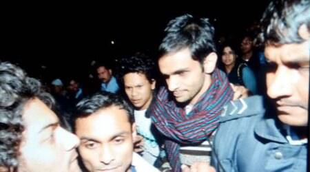 Hours after High Court nudge, Umar Khalid, JNU friend surrender to police