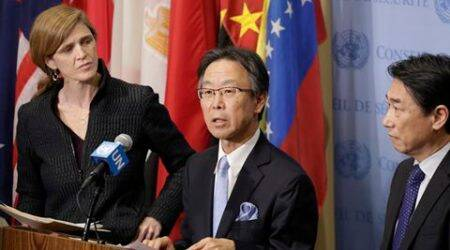 Motohide Yoshikawa, center, Japan's ambassador to the United Nations, speaks to the media following a Security Council meeting at U.N. headquarters, Sunday, Feb. 7, 2016. Samantha Power, left, the U.S. ambassador, and South Korean Ambassador Oh Joon listen to his comments. The council is meeting about North Korea's successful launch of a long-range missile. (AP Photo/Mark Lennihan)