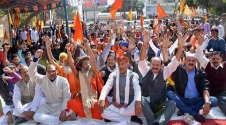 Ranchi : Vishwa Hindu Parishad (VHP) and Bajrang Dal activists stage a dharna near Rajbhawan in Ranchi on Monday. PTI Photo (PTI2_1_2016_000109B)