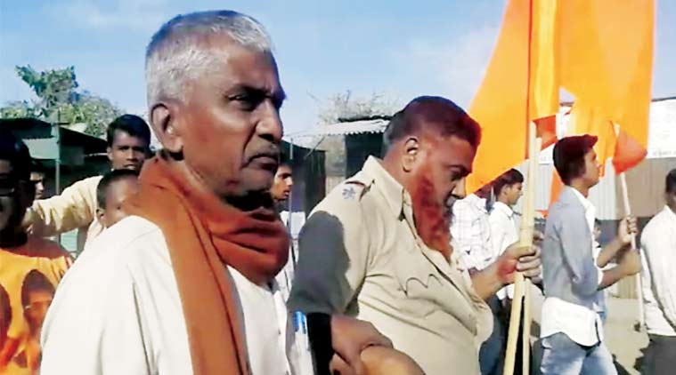 ASI Yunus Sheikh being paraded with the saffron flag.
