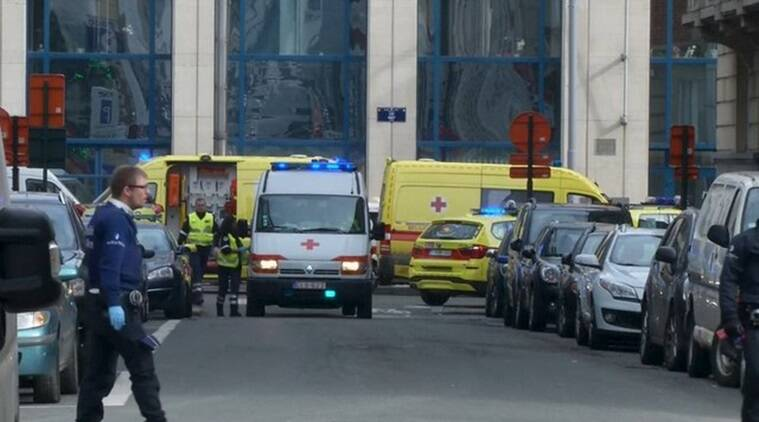 Emergency personnel are seen at the scene of a blast outside a metro station in Brussels. REUTERS/Reuters TV