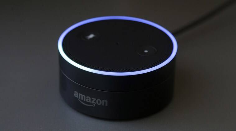 Amazon Echo Dot is a tiny little speaker with Alexa virtual assistant that can be connected to other speakers to extend Alexa's functions (Source: AP)