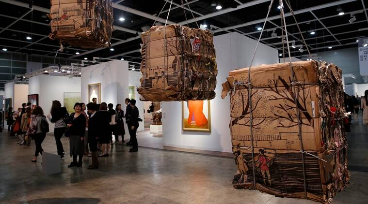"An artwork created by Indonesian artist Tintin Wulia is displayed during the VIP preview of the art fair ""Art Basel"" in Hong Kong, Tuesday, March 22, 2016. Wulia's collection of cardboard bales is the result of her yearlong investigation into a recycling micro-economy involving scrap collectors and Filipino migrant domestic workers who spend their days off in the heart of Hong Kong's financial district. She said the project examines how the material links seemingly unrelated groups in Hong Kong society and also symbolizes the city's widening wealth gap. (AP Photo/Kin Cheung)"