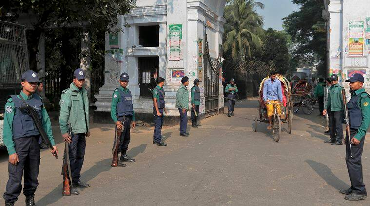 FILE - In this Jan. 6, 2016, file photo, Bangladeshi policemen stand guard at the entrance to the Supreme Court in Dhaka, Bangladesh. Bangladesh's highest court has upheld a death sentence for Mir Quasem Ali, a senior member of the country's largest Islamist party Jamaat-e-Islami, who was convicted of committing crimes against humanity during the country's independence war against Pakistan in 1971. (AP Photo/A.M. Ahad, File)