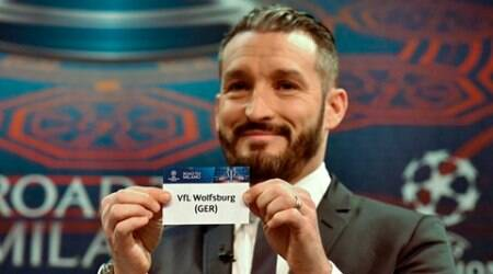 Gianluca Zambrotta, Ambassador for the Champions League final, shows the name of Club VfL Wolfsburg (GER) during the draw of the UEFA Champions League 2015-16 quarterfinal matches at the UEFA Headquarters in Nyon, Switzerland, Friday, March 18, 2015. (Christian Brun/Keystone via AP)