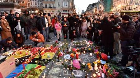 People bring flowers and candles to mourn at Place de la Bourse in the center of Brussels, Tuesday, March 22, 2016. Bombs exploded at the Brussels airport and one of the city's metro stations Tuesday, killing and wounding scores of people, as a European capital was again locked down amid heightened security threats. (AP Photo/Martin Meissner)