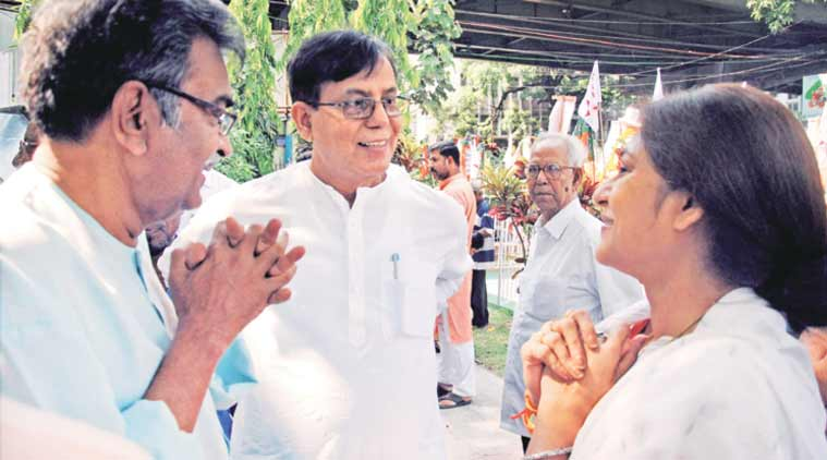 BJP women's wing chief and Howrah (North) candidate Rupa Ganguly with CPM leaders Mohammed Salim and Surjya Kanta Mishra in Kolkata on Wednesday morning. (Source: PTI)