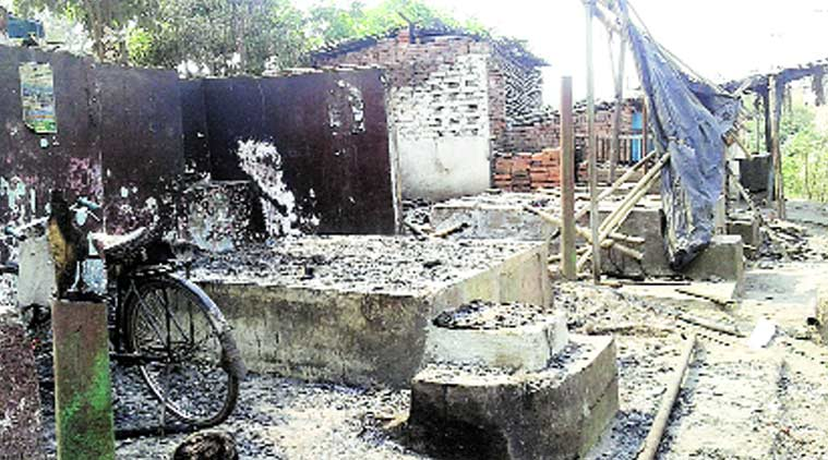 Shops burnt during the violence in Bermo Wednesday. Prashant Pandey