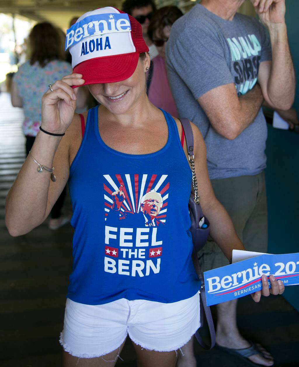 Hawaii voter Noelle Giamblvo shows off her Bernie Sanders's swag while waiting in line at the Hawaii caucus at Kailua Intermediary School, Saturday, March 26, 2016, in Kailua, Hawaii. (AP Photo/Marco Garcia)