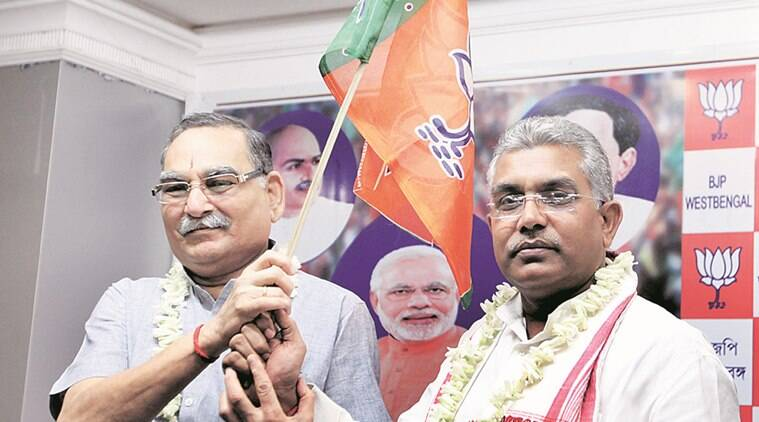Shantilal Jain(left) with BJP state president Dilip Ghosh during joining programme at party state headquarter on Saturday March 12, 2016. Shantilal left BJP and joins TMC few years back . Express photo by Partha Paul.