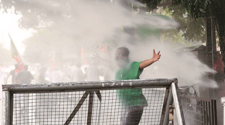 police use water canon on BJP workers during protest against Sashi Tharur at Chandigarh on Friday, March 25 2016. Express photo by Jasbir Malhi