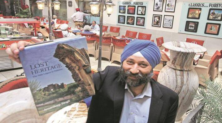 Amardeep Singh Author with his book `LOST HERITAGE' during a press conference in Chandigarh on Tuesday, March 01 2016. Express photo by Jaipal Singh