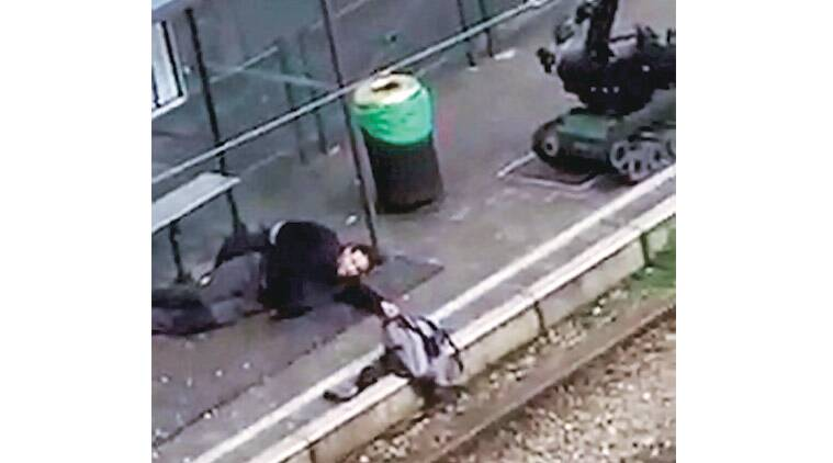 A suspect lies on the platform after he was shot and wounded by police in Brussels Friday. Reuters