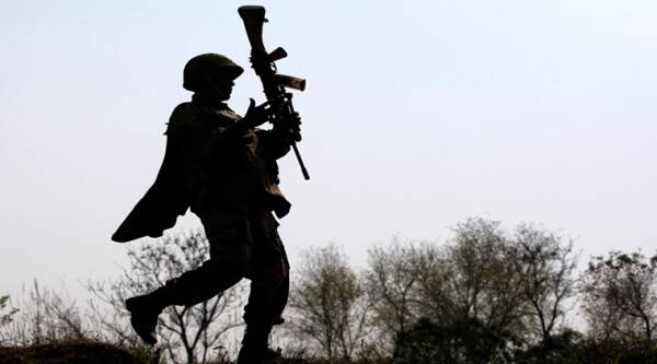 A Border Security Force or BSF soldier patrols an area where a 30-meter (98-foot) long tunnel was found in R.S. Pura sector at India-Pakistan border 35 kilometers (22 miles) from Jammu, India, Friday, March 4, 2016. The tunnel was allegedly dug from the Pakistani side to push arms and terrorists into Jammu city, said BSF Inspector Gen. Rakesh Sharma. (AP Photo/ Channi Anand)