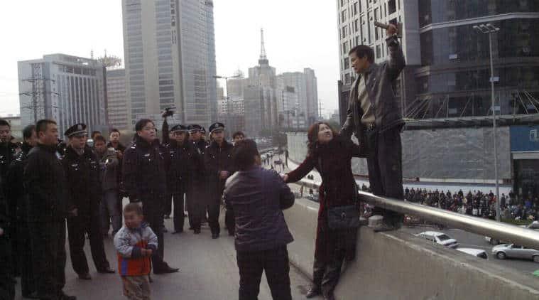 China, China public punishment, China workers publicly punished, China public sentencing, China workers public sentencing, China worker protest, Langzhong public sentencing, China wage protest, Asia news, World news