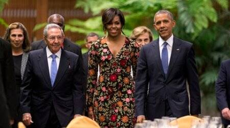 President Barack Obama, right, and first lady Michelle arrive for a state dinner with Cuba's President Raul Castro, left, at the Palace of the Revolution in Havana, Cuba, Monday, March 21, 2016. Obama's visit to Cuba is a crowning moment in his and Castro's bid to normalize ties between two countries that sit just 90 miles apart. (AP Photo/Rebecca Blackwell)
