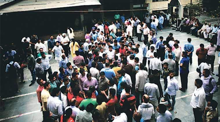 Family members and friends of Pankaj Narang gathered for a prayer meet at a temple Saturday.  (Express Photo: Praveen Khanna)