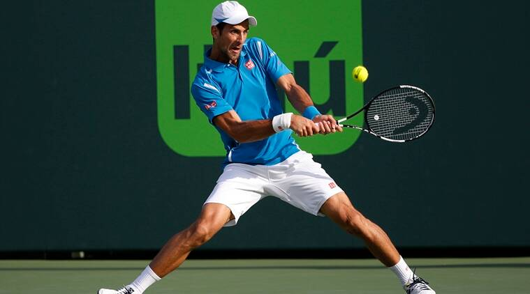 Mar 27, 2016; Key Biscayne, FL, USA; Novak Djokovic hits a backhand against Joao Sousa (not pictured) during day six of the Miami Open at Crandon Park Tennis Center. Djokovic won 6-4, 6-1. Mandatory Credit: Geoff Burke-USA TODAY Sports