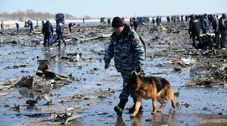 Rostov-on-Don : Russian Police and Emergency Ministry employees investigate the wreckage of a crashed plane at the Rostov-on-Don airport, about 950 kilometers (600 miles) south of Moscow, Russia, Sunday, March 20, 2016. Winds were gusting before dawn Saturday over the airport in the southern Russian city of Rostov-on-Don when a plane carrying 62 people from a favorite Russian holiday destination decided to abort its landing. AP/PTI(AP3_20_2016_000077A)