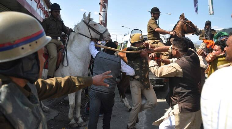 Dehradun, BJP Mla Ganesh Joshi Beat the Police Horse 'Shaktiman' Activists in the break through a Police Barricade during in a Protest Against State Goverament on near Assembly .photo,virender.singh .negi