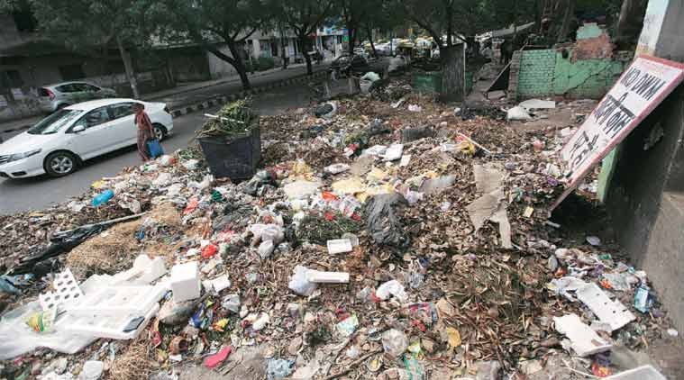 Garbage strewn on the road at Hauz Khas Enclave in south Delhi Wednesday. (Express Photo: Tashi Tobgyal)