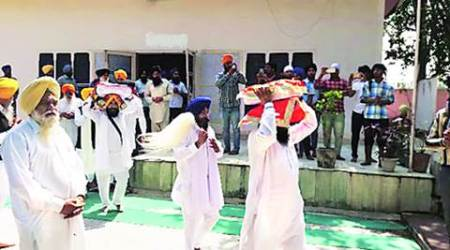 After complaints of liquor being offered, Guru Granth Sahib moved from dera